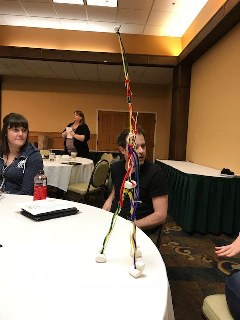 """The Conference """"Ice Breaker"""" Each table was given a bag of 30 items. The group at each table was instructed to build a structure using all 30 items. The tallest structure wins."""